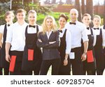 a large group of waiters and... | Shutterstock . vector #609285704