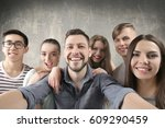 happy young friends taking... | Shutterstock . vector #609290459