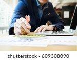 businessman holding a darts... | Shutterstock . vector #609308090