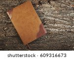 diary on a wooden old background | Shutterstock . vector #609316673