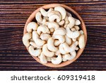 cashew nuts in wooden bowl over ... | Shutterstock . vector #609319418