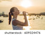 sporty woman drinking water... | Shutterstock . vector #609324476