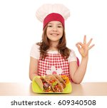 happy little girl cook with...