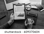 man works with documents and... | Shutterstock . vector #609370604