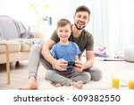 father and son playing... | Shutterstock . vector #609382550