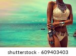 slim and tanned girl in trendy... | Shutterstock . vector #609403403