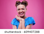 toothy smiling lovely girl with ... | Shutterstock . vector #609407288
