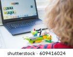 boy in robotics school makes...   Shutterstock . vector #609416024