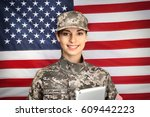 Female Soldier With Tablet On...