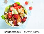 fresh fruit salad with homemade ... | Shutterstock . vector #609447398