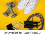 sport shoes  dumbbells  mobile... | Shutterstock . vector #609448010