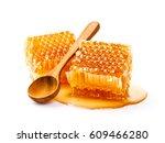 honeycomb with honey spoon... | Shutterstock . vector #609466280