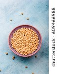 soy beans in a bowl on table | Shutterstock . vector #609466988