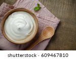 yogurt in wooden bowl on wooden ... | Shutterstock . vector #609467810