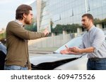 two men arguing after a car... | Shutterstock . vector #609475526