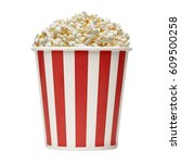 popcorn in striped bucket on... | Shutterstock . vector #609500258