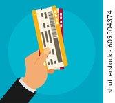 hand holding boarding pass... | Shutterstock .eps vector #609504374