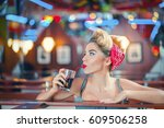young woman in retro cafe | Shutterstock . vector #609506258