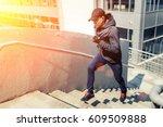 young sports man with earphones ...   Shutterstock . vector #609509888