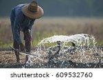 men are watering vegetables ... | Shutterstock . vector #609532760