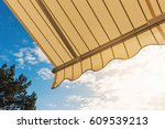 awning against blue sunny sky | Shutterstock . vector #609539213