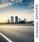 empty asphalt road of a modern... | Shutterstock . vector #609555920