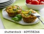 two mini quiches served on... | Shutterstock . vector #609558266