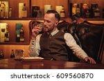 confident upper class man... | Shutterstock . vector #609560870