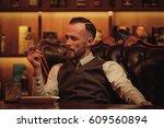confident upper class man... | Shutterstock . vector #609560894