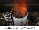 bbq chimney starter with flames ... | Shutterstock . vector #609562550
