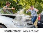 two men arguing after a car... | Shutterstock . vector #609575669