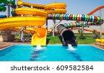 aquapark sliders with pool | Shutterstock . vector #609582584