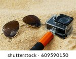 sunglasses and action cam on... | Shutterstock . vector #609590150