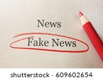 red pencil with fake news... | Shutterstock . vector #609602654