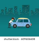business man repairing car at... | Shutterstock .eps vector #609606608