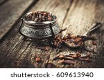 cloves  old wooden background | Shutterstock . vector #609613940