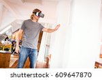 young man in his apartment ... | Shutterstock . vector #609647870