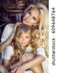 beautiful young mother with her ... | Shutterstock . vector #609648764