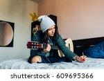 young beautiful woman composing ... | Shutterstock . vector #609695366