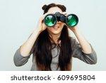 girl with binoculars | Shutterstock . vector #609695804