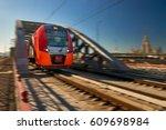 bright red high speed passenger ... | Shutterstock . vector #609698984