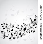 music notes on a solide white... | Shutterstock .eps vector #609729284