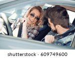 young couple together in car  ... | Shutterstock . vector #609749600