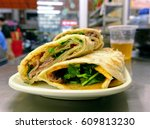 rolled pancakes stuffed with... | Shutterstock . vector #609813230