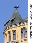 Small photo of Roof ornamentation with a cat sculpture in old Riga, Latvia