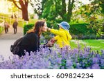 beautiful mother with son in... | Shutterstock . vector #609824234