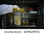 scientists take anaerobic jar... | Shutterstock . vector #609828953