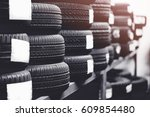 tires for sale at a tire store... | Shutterstock . vector #609854480