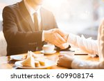 handshake of businessmen during ... | Shutterstock . vector #609908174