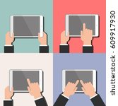 a tablet in the hands.... | Shutterstock .eps vector #609917930